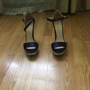 High heel and platform sandals by Prada